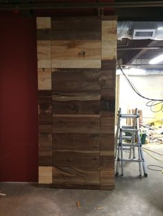 Here is the first of our two hidden doors, We clad a fire door with rough cut lumber and mounted the door with Soss hidden hinges. The clearances on the the door jam is a mere 1/8 inch. There is another pic on this board that shows the door open.