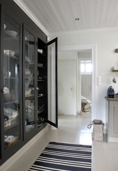 In this farmhouse kitchen they eliminated upper cabinets and built this large wall-to-wall cabinet at the far end instead.
