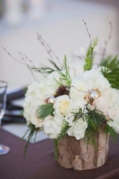 Winter centerpiece with wooden vase and metallic ornaments
