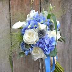 Rustic Hand Tied Wedding Bouquet Arranged With: Blue Hydrangea, Blue Echinops (Globe Thistles), White Roses, White Lisianthus, White Calla Lilies + Greenery/Foliage Wedding Arbor Rustic, Rustic Wedding Save The Dates, Wedding Cake Rustic, Rustic Wedding Centerpieces, Wedding Ties, Bridesmaid Bouquet, Wedding Bouquets, Blue And White Roses, Bouquet Champetre