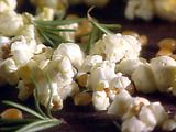 Popcorn with Rosemary Infused Oil Recipe - Rosemary Infused Oil:    1 cup olive oil  5 to 6 fresh rosemary sprigs (each 5 inches long)    Combine the oil and rosemary in a heavy small saucepan. Cook over medium-low heat for about 5 minutes. Remove from the heat and let cool to room temperature. Transfer the sprigs to a 4-ounce bottle or cruet. Add the oil and seal the lid. Refrigerate for up to 1 month.