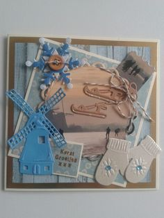 Kerstkaart met molen. Handschoenen. Friesdoorlopers en sneeuwster...dit alles gestanst met sissixmachine.. Even versieren met restjes en je hebt een prachtige kaart.