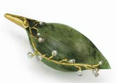 A rare and important jeweled and gold-mounted nephrite study of a lily of the valley leaf