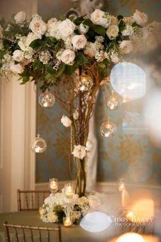 OMG I love the hanging tea lights. (Beautiful tall centerpiece with hanging tea lights Branch Centerpieces, Candle Wedding Centerpieces, Floral Centerpieces, Flower Arrangements, Centerpiece Ideas, Centerpieces With Lights, Floral Wedding, Wedding Flowers, Trendy Wedding