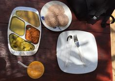 A traditional Sri Lankan breakfast of string hoppers, dhal, potato curry and coconut sambol