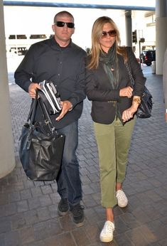 Jennifer Aniston Canvas Sneakers - Jennifer Aniston was dressed down and comfy in white Superga sneakers, army pants, and a blazer while catching a flight out of LAX. Jennifer Ainston, Jennifer Aniston Style, Army Pants, Superga Sneakers, Canvas Sneakers, Denim Fashion, Casual Looks, Military Jacket, Fall Outfits