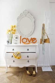 love the 'love', timeless white dresser, so cool coatrack