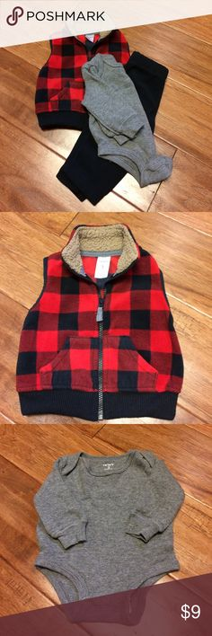 Cute fleece Christmas outfit. Fleece Christmas outfit. Only worn once. Comes with grey thermal onesie, red and black vest, and black fleece pants. Smoke free home. Great bundle deals!! Carter's Matching Sets