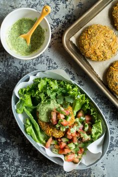 Moroccan Yam Veggie Burgers with Cilanto-Lime Tahini Sauce! Vegan + Gluten-free. By Oh She Glows.