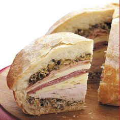 Italian Muffuletta... In a basket...with a great bottle of red wine {don't forget the glasses}, a couple of different cheeses, grapes, kettle potato chips, a citronella candle, a blanket & your favorite person in the whole wide world...and you will have a picnic to remember.... P.S. you can pick the place.