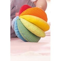 Haba Rainbow Fabric ball - bet I could make this using half circles sewing together, stuff, hand stitch/machine the base and then sew together into the center.