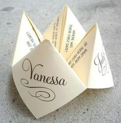 Custom designed cootie catcher for tables at reception -- fun way to learn more about bride and groom wedding decorations cheap indoor Save Your Budget with Fun and Quirky Wedding Party Games Wedding Table Games, Wedding Games For Guests, Wedding Trivia, Wedding Venues, Wedding Placecard Ideas, Wedding Ceremony, Wedding Tables, Games For Weddings, Wedding Programs