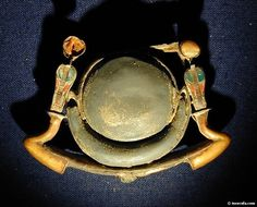 King Tutankhamun's Toth Crescent moon and sun on a solar barque with 2 Ouret cobras crowned with sun discs. Cairo Egyptian museum.