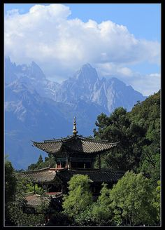 """Dragon & dragon"" ~ Photograph (by Bernard Blanchard) of a pagoda on the edge of the Black Dragon pond with the Mount of the Jade Dragon in the background, in Lijiang, Yunnan Province, China."