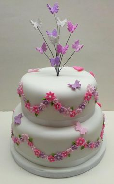 """Wedding Cake, A 6"""" & 8"""" moist fruit cake with pretty pink flowers and butterflies."""