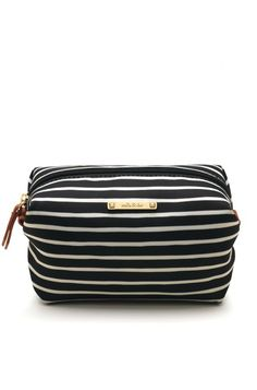 Stash your makeup in style in our new Pouf in Black and Cream Stripe. Shop makeup and accessory bags at Stella & Dot.