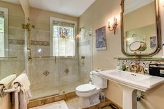 Traditional 3/4 Bathroom with Daltile Sonoma Honed Travertine, Wall sconce, High ceiling, Pedestal Sink, Handheld Shower Head