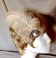 A personal favorite from my Etsy shop https://www.etsy.com/listing/248391180/cream-ivory-ostrich-feather-and-vintage