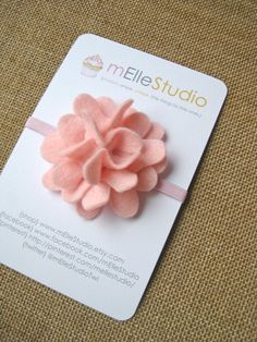 ON CLEARANCE / WAS $9.50 / NOW $5.70 An intricate blush pink felt flower headband for your beautiful little girl! What a perfect accessory to dress up