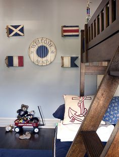 Adorable nautical brown & blue boy's room design with wood bunk beds, blue walls paint ...