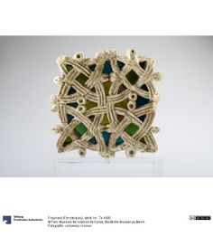 Window glass fragment dating to 709 in israel.