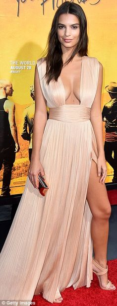 Like a Grecian goddess: Emily showcased her ample cleavage in a plunging blush pink gown...