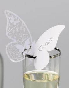 White Intricate Butterfly Place Cards for Glasses.  Wonder if I could create something similiar on my Silhouette