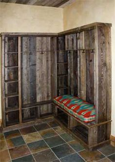 Barn wood shelving and earth-toned tiles hide the dirt.