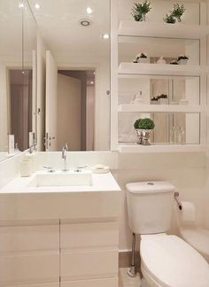 Love the mirrored floating shelves.