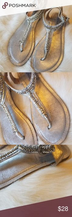 Steve Madden Guesst Leather Jeweled Sandals The silver sandals are from Steve Madden, It is a t strap style with an ankle strap. The front is bejeweled silver jewels. Condition: Used. In good condition with a lot of life left! Size: 8M Retail:$80 Make an offer or add to a bundle for a private offer! Steve Madden Shoes Sandals