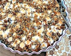 Sweet Potato Casserole ♥ AVeggieVenture.com, traditional sweet potato casserole, updated. Think way-fewer-than-usual mini marshmallows, hints of vanilla and ginger, plus a pecan-panko topping. Delish!