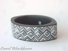 Carol Blackburn, oval bangle in black & white Zig Zag pattern, polymer clay.