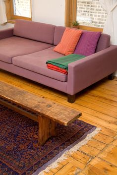 Dan's Apartment of Artful Assemblages House Tour | Apartment Therapy - - living room foot rest