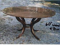 Artisan Furniture & Cabinetry   Contemporary 60'' Dia. Walnut Dining table.    Patterned top highly polished