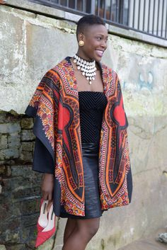 Stunning African print oversized play collar coat. This coat is very warm, elegant and very versatile. Ive used a beautiful black wool to compliment