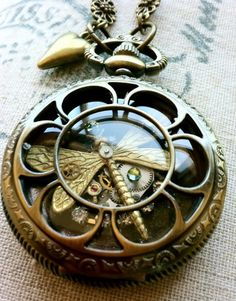 gorgeous dragonfly pocket-watch style locket with peridot