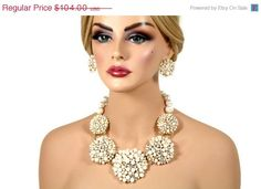 Hey, I found this really awesome Etsy listing at http://www.etsy.com/listing/153080333/gold-ivory-pearl-crystal-bridal
