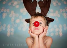 Christmas light bokeh with toddler as Rudolph Sweet Pickle Pictures Manhattan Kansas Studio Photography