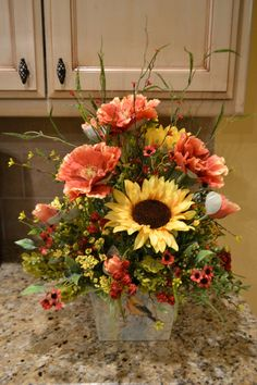 This arrangement is full of beautiful flowers and is made in a metal container with a bird pictured on the front. It would make a beautiful centerpiece! It measures approx. Summer Flower Arrangements, Artificial Floral Arrangements, Beautiful Flower Arrangements, Summer Flowers, Artificial Flowers, Beautiful Flowers, Cemetery Flowers, Flower Bouquet Wedding, Bridal Bouquets