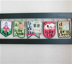 This banner frame has pennants from Birthday Bash that can be switched out for different seasons. They are hanging on floral wire that suspends in a store bought frame. Cute for nursery wall. from cricut.com