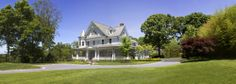 6500 square foot Victorian style home complete with a beautiful slate roof, walnut floors, infinity edge pool, wrap around porch, waterview and geothermal heating and cooling. Builder: Stokkers & Company, Architect: Smiros & Smiros, Location: Lloyd Harbor, NY