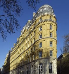 The exterior of Corinthia Hotel London - Whitehall Place to the left & Northumberland Avenue to the right.