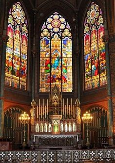 Trinity inspired stained glass behind the altar - so lovely!