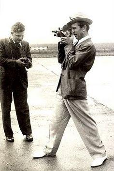 Walt Disney looking very dapper taking photos in Paris.