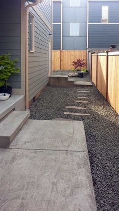 No-maintenance landscaping example in Tumwater Hill. Included cedar privacy fence, rock garden and landscape beds. Low Maintenance Landscaping, Cedar Fence, Townhouse, Modern Design, Yard, Landscape, Architecture, Outdoor Decor, Fencing
