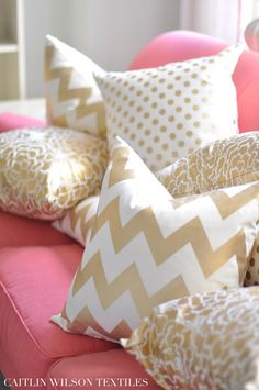 caitlin wilson design: gold pillows with different patterns. Wowhoo! Ideas for ways to decorate a pink/coral couch!
