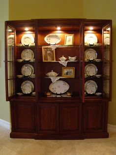 China Cabinet Decoration I Would Use Different Colors But Like The Varied Heights Add Lights To Greens