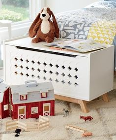 Designed just for us by Bill Eastburn, our Stuart Toy Box not only keeps your playroom looking cleaner, but it looks pretty good doing it, too. The stylish two-tone design and front panel with cutout details make it the most stylish toy box on the block.