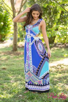 This dress has all of the colors of a city skyline at dusk! Featuring gorgeous shades of blue, teal, black, yellow, grey, purple, peach, and white, this geometric patterned dress is a knockout! And that's before you even take into account the stunning details - we adore the open back, cutouts on the side, and low cut scoopneck!