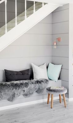 Understairs nook with shiplap wall cladding by threebirdsrenovations